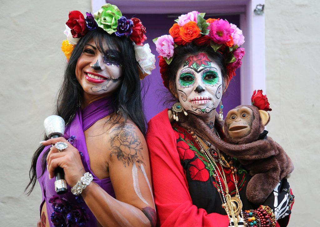 Ines Magana Picasso (left) and Estella Olivas attend the Dia de los Muertos festival Saturday at La Villita. <em><b>Photo by Ben Olivo | Heron</b></em>