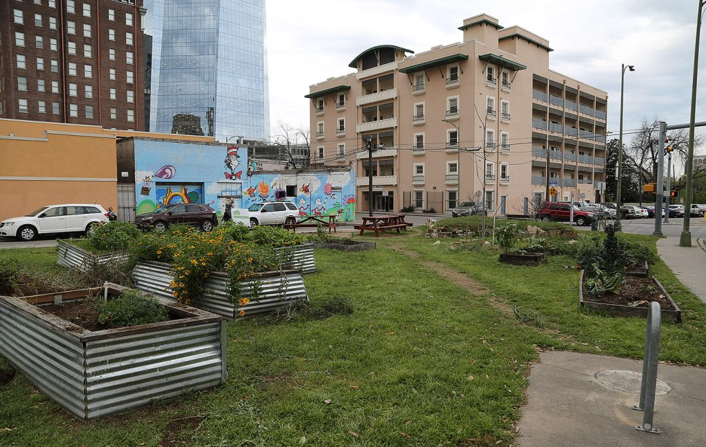 The Little Patch Garden, 405 N. Main Ave., is seen in this photo in March 2019. The small warehouse with the Dr. Suess mural was demolished June 31, 2019. Developer Weston Urban owns both properties