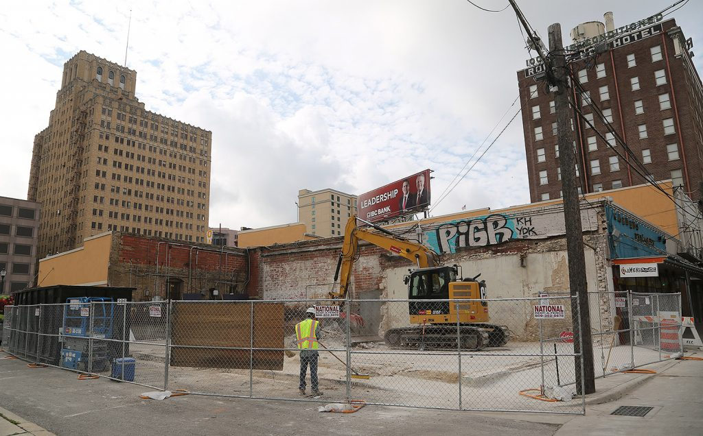 Crews clean up a property at 326 N. Flores St., which is owned by Weston Urban, on Monday, June 3, 2019. The developer demolished the building beginning Thursday, May 30, 2019.