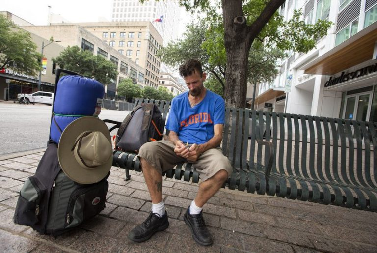 Daniel Johnson, who is homeless, sits on a bench on Congress Avenue in downtown Austin. Photo by Marjorie Kamys Cotera for The Texas Tribune