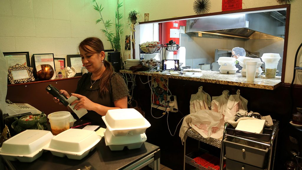 Thai Lucky owner Veida Thirath gets to-go order ready at the location on South Pine Street. Thirath is getting ready to open another location downtown at 102 Navarro St.