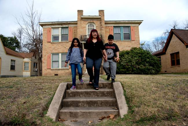 Melissa Romo lives with her children Mia and Zavier on San Antonio's West Side. Photo by Robin Jerstad for The Texas Tribune