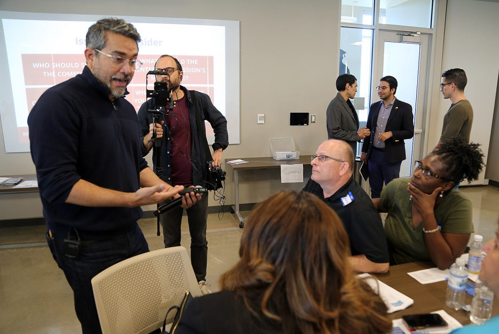 District 1 Councilman Roberto Treviño talks with attendees of a town hall on the possibility of a renters commission on Saturday, Feb. 29, 2020, at San Antonio College.