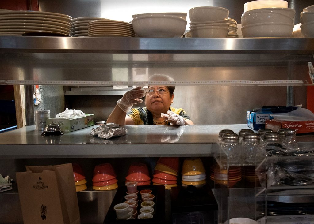 Blanca Estrada looks at an order inside Mama's Kitchen March 26 at 504 W. Hildebrand Ave. Photo by V. Finster   Heron Contributor