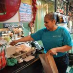 Owner Maria Beza, 59, packs an order at Maria's Cafe, March 26, at 1105 Nogalitos. Photo by V. Finster   Heron Contributor