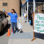 Maria Alonso, a substitute teacher at J.T. Brackenridge Elementary on the near West Side, loads free meals to parents on Wednesday, April 1, 2020.