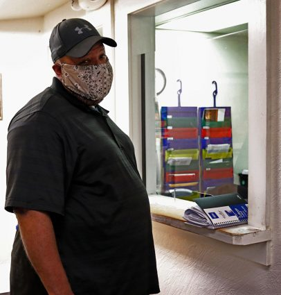 Kevin Gandy, US Air Force Veteran, waits to talk with an employee at the American GI Forum June 30 at 206 San Pedro Ave. Gandy received paperwork to fill out for housing to see if approved.