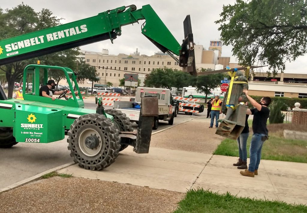 The Christopher Columbus statue is removed Wednesday morning, July 1, 2020, from Columbus Park downtown.