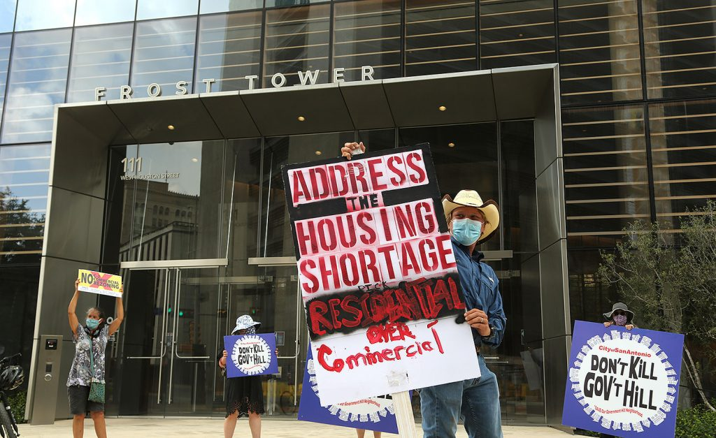 Caleb James, a resident of Government Hill since 2019, leads a protest in front of the Frost Tower on Saturday, July 18, 2020.