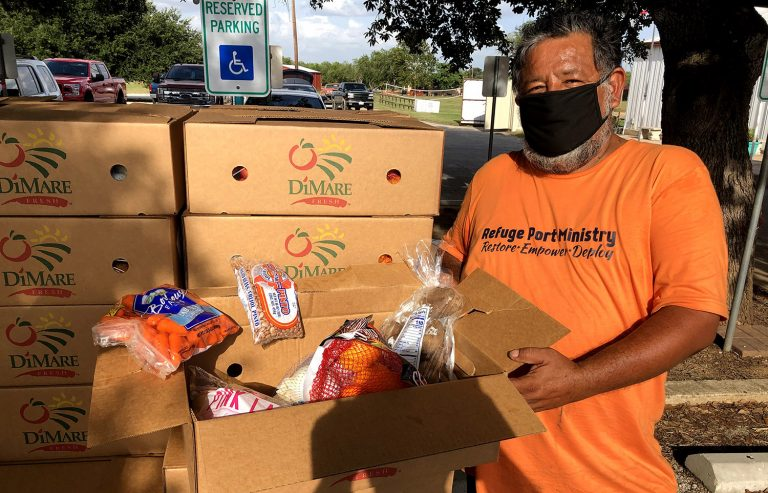 Martin Medellin leads a food distribution at the parking lot of Southside Baptist Church on a recent Thursday, July 30, 2020.