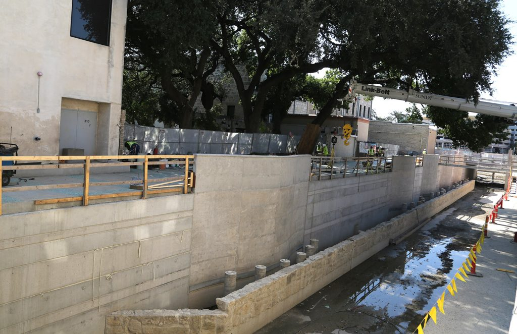 The San Pedro Creek Culture Park under construction on Monday Aug. 24, 2020 where the Spanish Governor's Palace backs up to it.