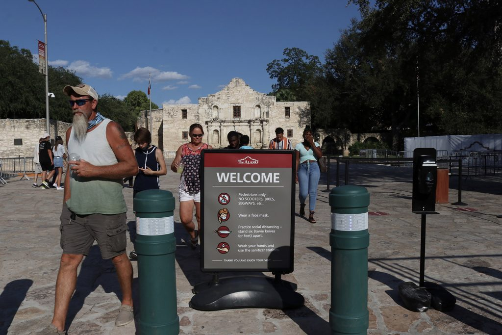 Visitors walk Alamo Plaza on Saturday, Aug. 29, 2020.