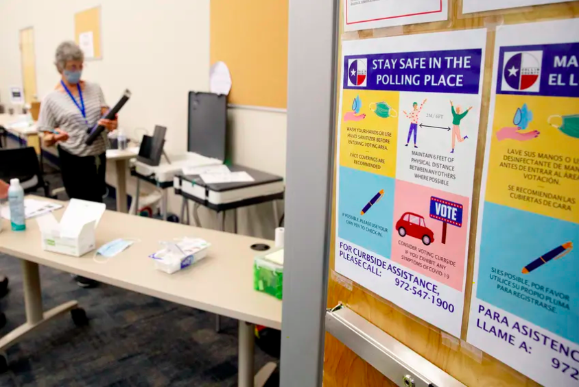 The Collin County Elections Department created a mock polling site to prepare poll workers for early voting in June. It included signs to inform voters and employees on how to reduce the risk of spreading COVID-19 during the voting process.
