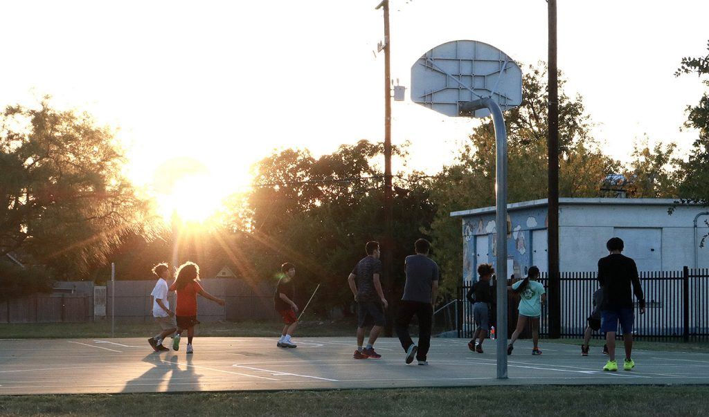 Kids play on the basketball court at Labor Street Park on Sept. 29, 2020.