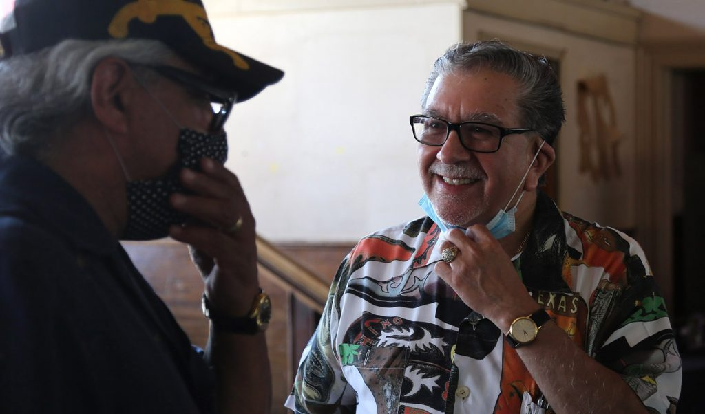 Jesus Medina (right) owner of the Cadillac Bar, chats with Jerry Galvan, 70, a longtime patron of the bar during a rummage sale on Saturday, Oct. 3, 2020.