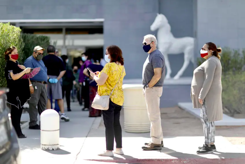 Voters wait in line to cast their ballots at the Sunland Park Mall in El Paso on the first day of early voting.