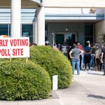 People wait in line at Las Palmas Library on the West Side as early voting began on Tuesday, Oct. 13, 2020.