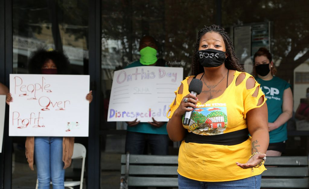 Jacquline Caldwell speaks at a protest in front of SAHA headquarters on Saturday, NOv. 21, 2020.