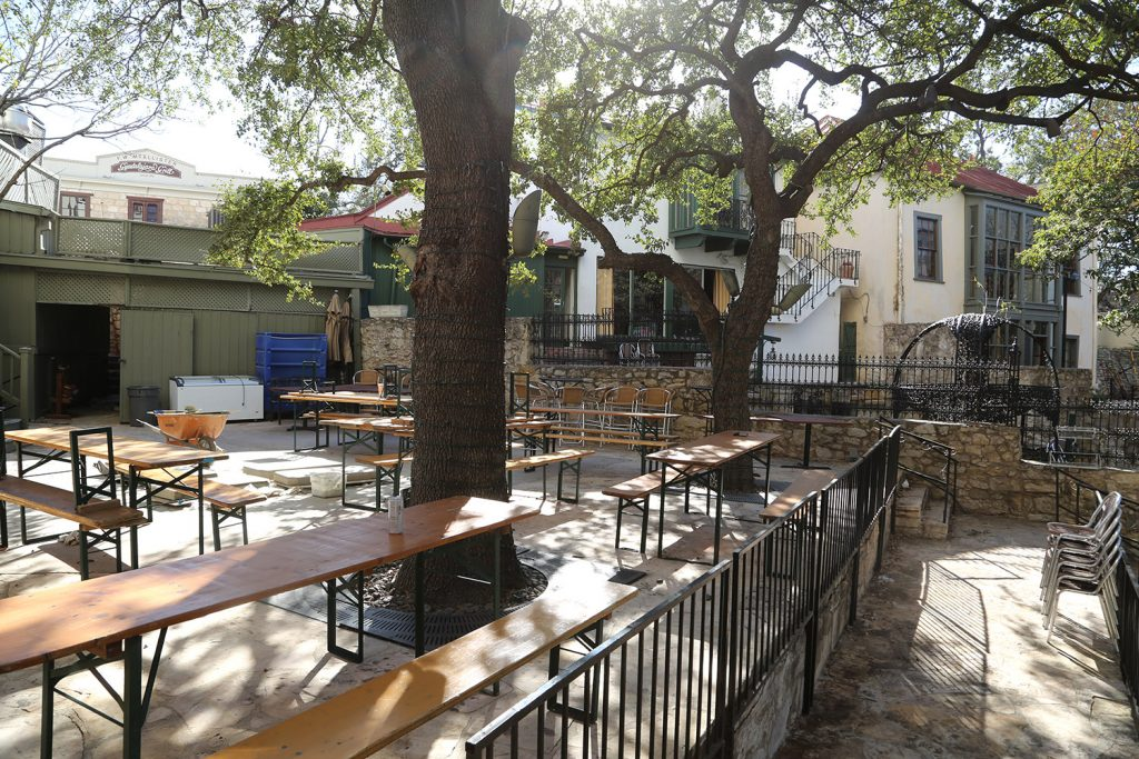 Picnic tables are set for the Little Rhein Prost Haus on the River Walk at 231 S. Alamo St.