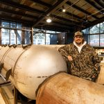 Grant Pinkerton, owner of Pinkerton's Barbecue, poses for a photo inside the pit room of his new restaurant at Weston Urban park.