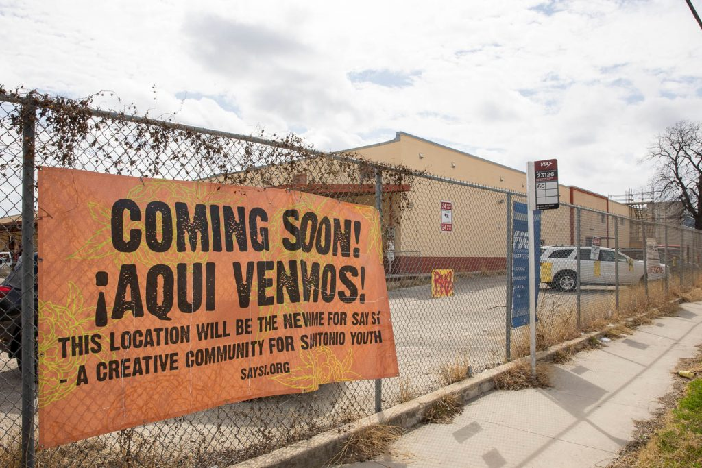 A SAY Sí sign hangs on the fence outside the new expanded campus located on the West Side of San Antonio on March 10, 2021.
