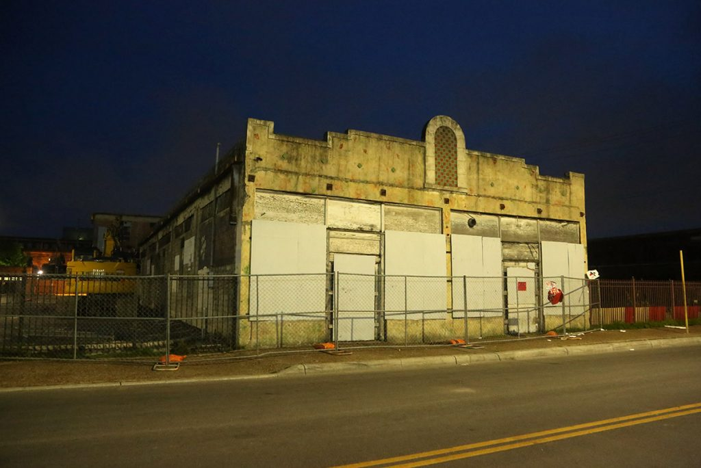 The Whitt building as it stands 821 W. Commerce St. on the night of May 30, 2021. Facade faces West Houston Street.