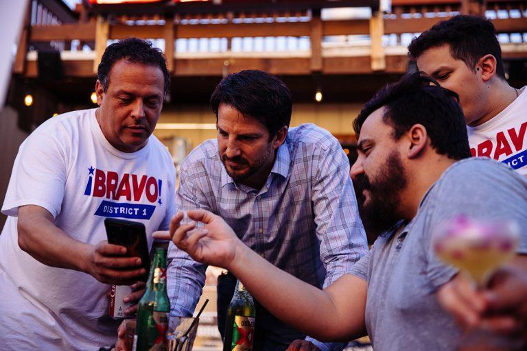 District 1 challenger Mario Bravo looks over results from Saturday night's runoff election with senior advisor Tomas Larralde and Bert Santibańez.