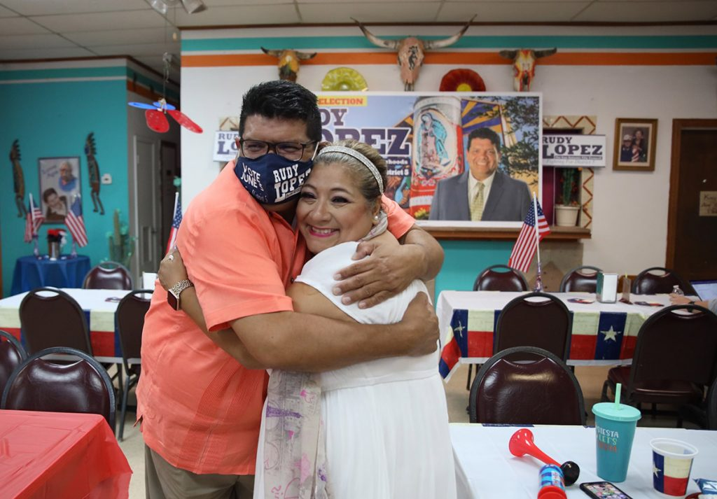 Rudy Lopez hugs supporter Rosita Lira at his election watch party at the Arizona Cafe on South General McMullen Drive on Saturday, June 5, 2021.