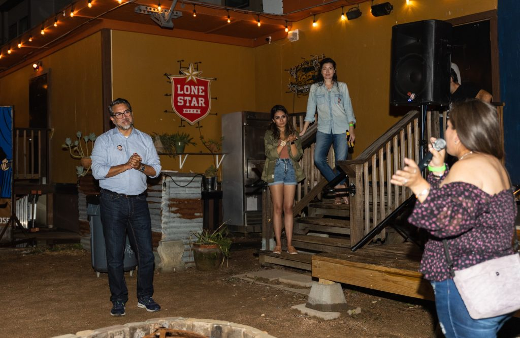 District 1 Councilman Roberto Treviño listens to Lupita Gutierrez of the Dellview neighborhood Saturday night at The Lonesome Rose.