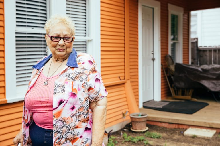 Lucille LeBlanc stands outside her Denver Heights home, which was recently renovated thanks to a city program.