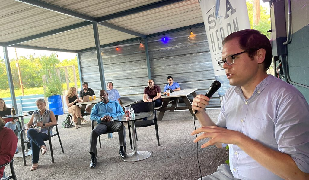 Heron contributor Richard Webner talks about public facility corporations during a Q&A with Heron editor Ben Olivo at The Dakota East Side Icehouse, 433 S. Hackberry St.