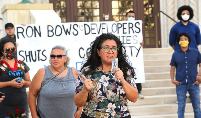Jessica O. Guerrero, former chairwoman of the Housing Commission, airs her grievances at a protest in front of City Hall on July 14, 2021.