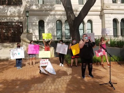 Advocates protest the potential appointment of former Councilwoman Shirley Gonzales as chair of the Housing Commission in front of City Hall on July 22, 2021.