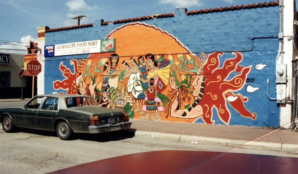 """The original """"Comprando y Prestando"""" mural in 1996 on the corner of Guadalupe and South San Jacinto streets."""