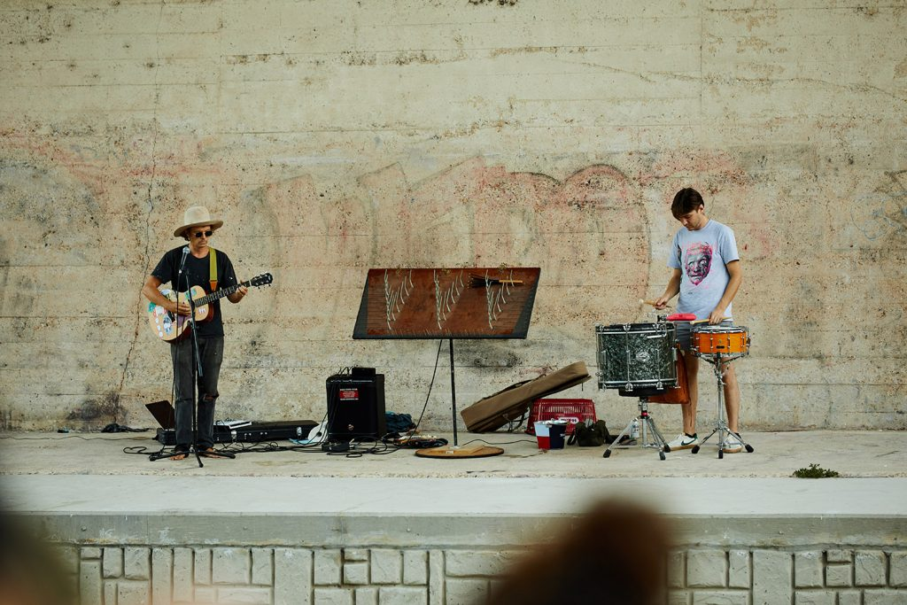 Bill Baird (left) and Jordan Johns perform Aug. 28 under the Roosevelt Avenue Bridge.