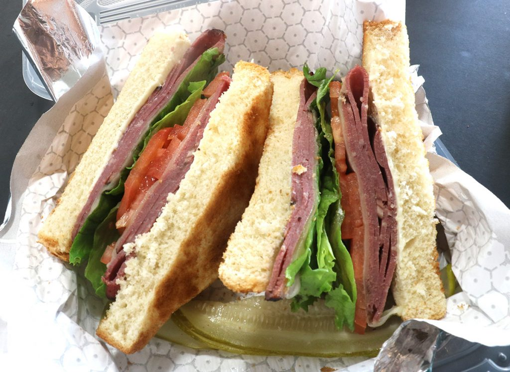 A build-your-own sandwich of pastrami with lettuce, tomatoes, and mayo on Texas toast.