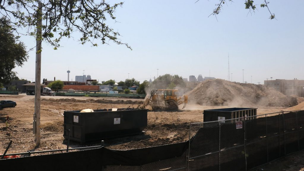 Construction work continues on Oct. 6 on Encore Multifamily's 386-unit apartment building that consumes most of the land bound by North Alamo, East Grayson, Austin, and West Carson streets.